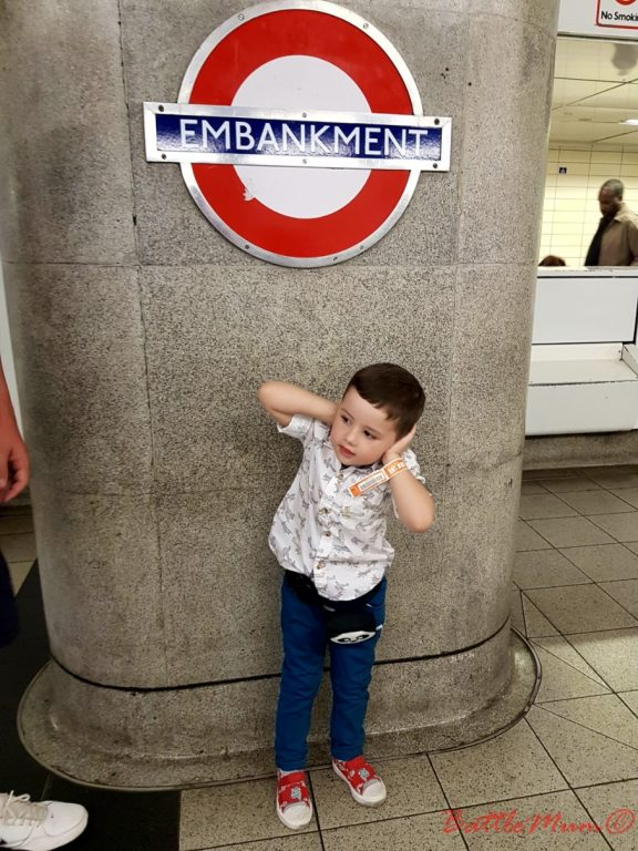 family day in london - BattleKid covering his ears to reduce the noise of the underground trains approaching