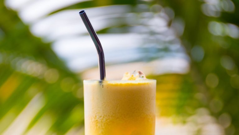 9 Easy Ways To Become Plastic Free At Home - Ways to Reduce your Plastic Waste - A stainless steel straw in a smoothie drink.