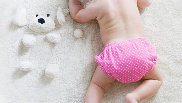 9 Easy Ways To Become Plastic Free At Home - Ways to Reduce your Plastic Waste - A baby in a cloth, reusable nappy.
