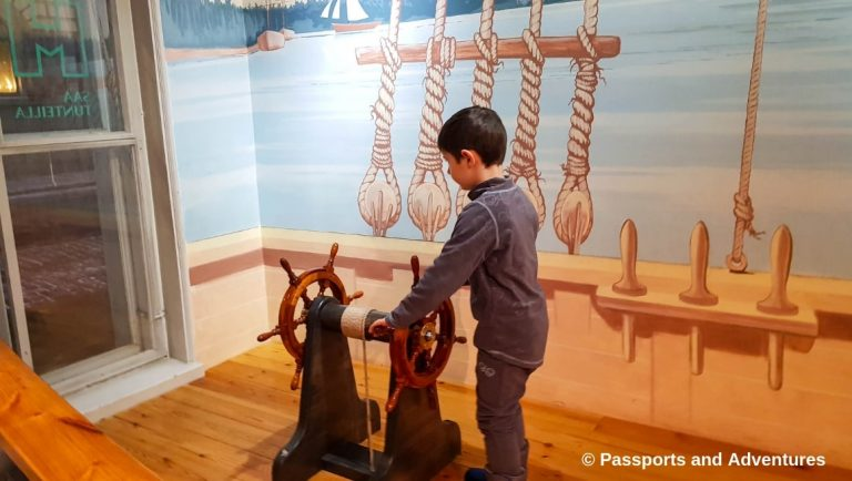 Boy playing on a pirate ship in Children's Town at the Helsinki City Museum