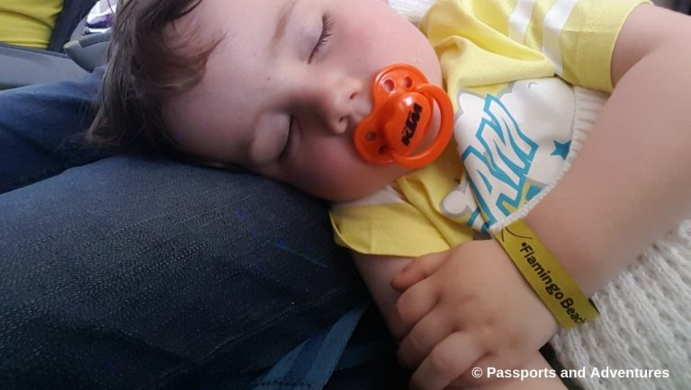 Awesome Tips For Flying With Babies and Toddlers - A toddler asleep on an airplane