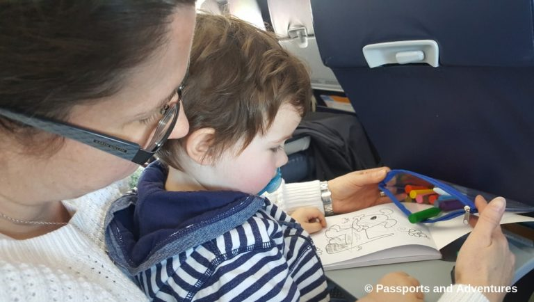 Awesome Tips For Flying With Babies and Toddlers - Mum and toddler colouring in with crayons on a plane