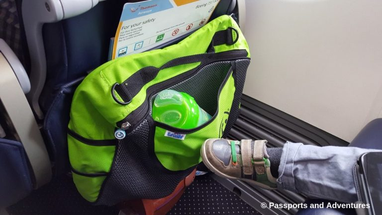 Awesome Tips For Flying With Babies and Toddlers - A Trunki insert bag on the back of an airplane seat