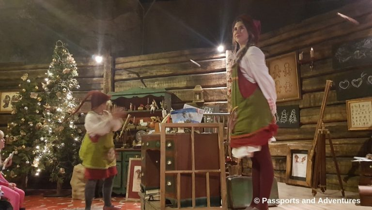 Awesome Things To Do In Rovaniemi With Kids - Two elves in a classroom teaching people to become elves at Santa Park.