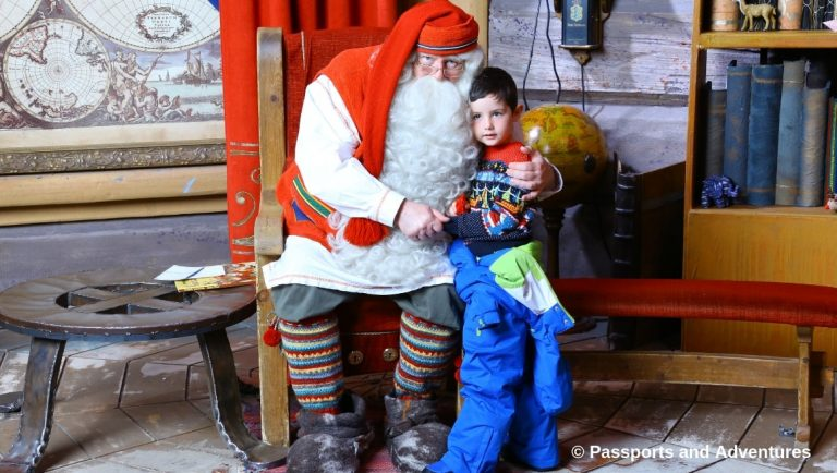 Awesome Things To Do In Rovaniemi With Kids - Oue boy meeting Santa Claus in his Office at Santa Claus Village.