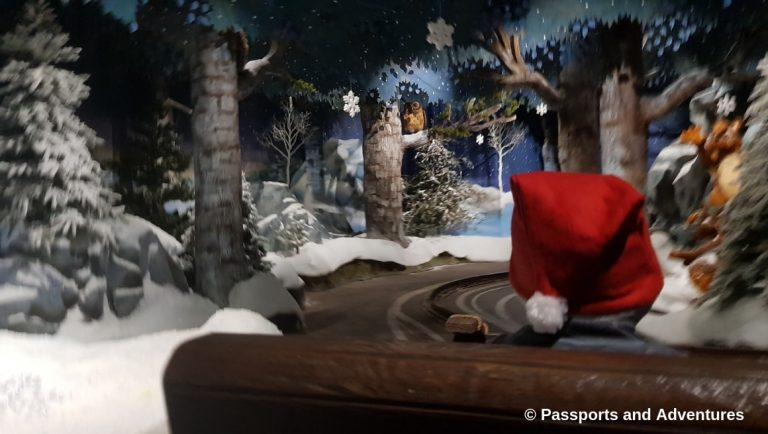 Awesome Things To Do In Rovaniemi With Kids - A snowy scene from Santa's Magic Train ride at Santa Park.