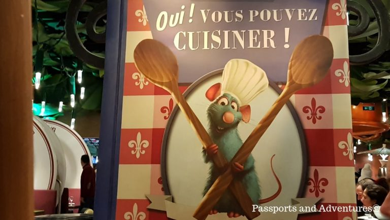 A poster from Bistro Chez Remy featuring the rat star of the film - One of the best restaurants in Disneyland Paris