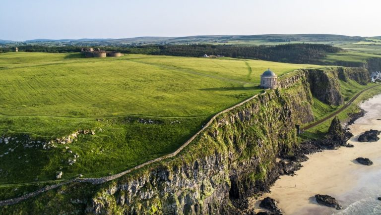 The Coastal Causeway with the Mussenden Temple on top of a cliff.