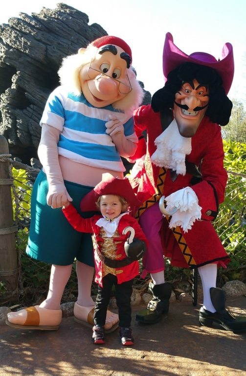 A mini Captain Hook with the character in Disneyland Paris