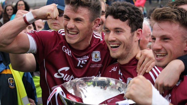 The Galway GAA team winning a cup.