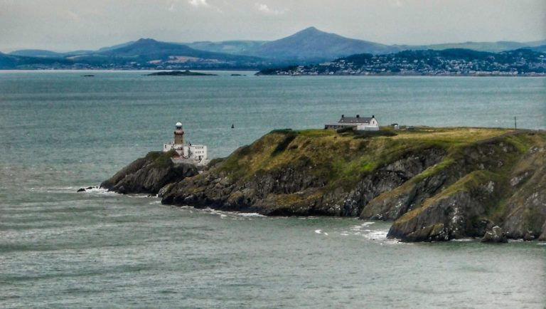 Howth Lighthouse with Sugar Loaf mountain in the background, Dublin.
