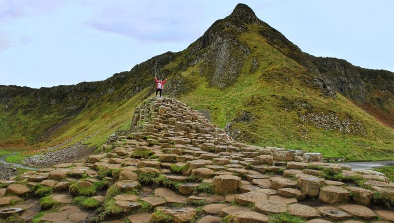 A girl on top of some of the Giant's Causeway.
