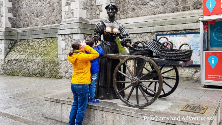 A Mum and her son pulling silly faces at the Molly Malone statue in Dublin, Ireland