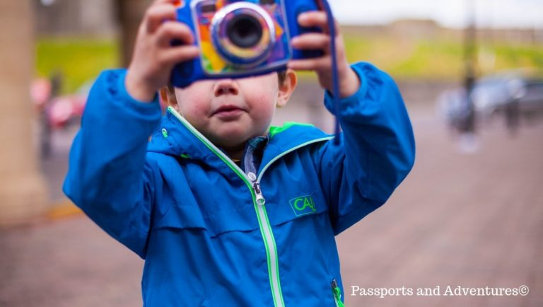 Little boy taking a picture with his own camera