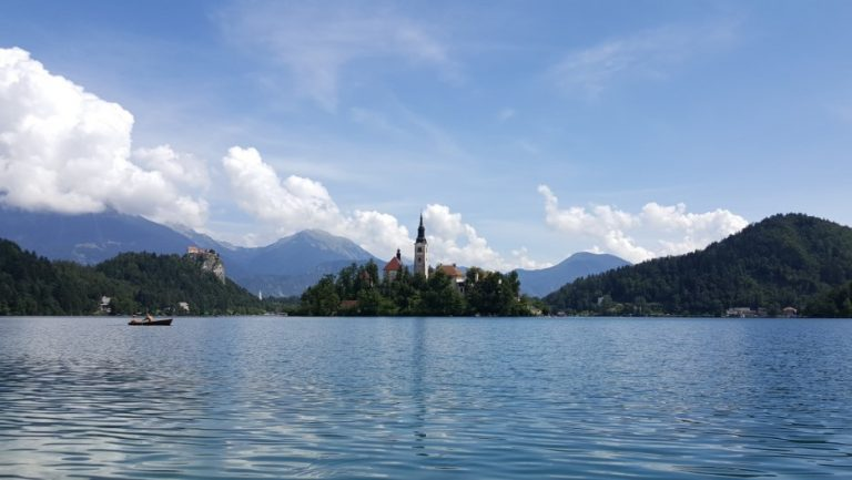 Lake Bled island with the church bell tower visible through the trees