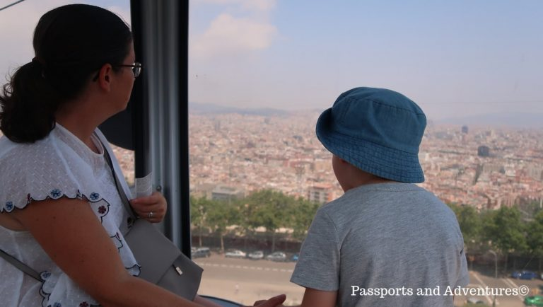 A mum and her son admiring the view of Barcelona from the Montjuic Cable Car