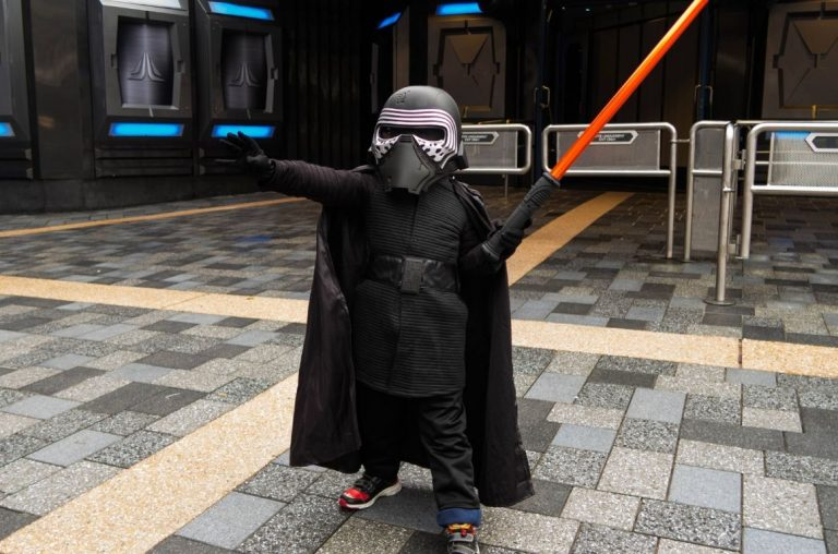 A young kid dressed as Kylo Ren from Star Wars in Disneyland Paris
