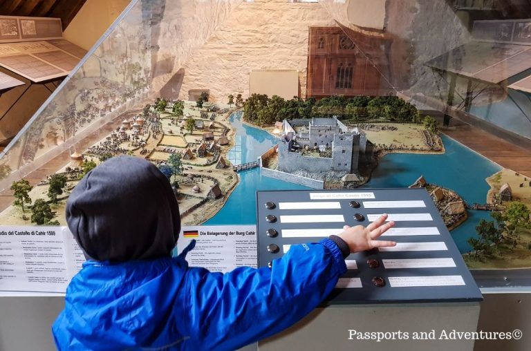 A young boy playing with the interactive model of Cahir Castle, Ireland