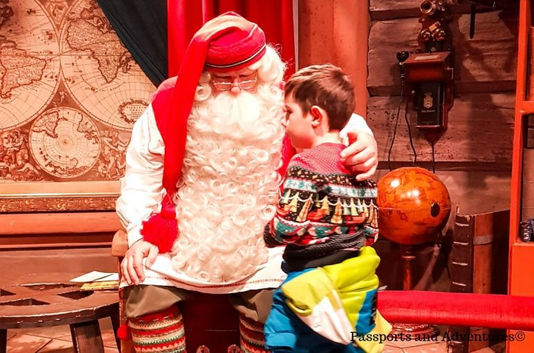 A young boy meeting the REAL Santa Claus at Santa Village, Rovniemi, Lapland