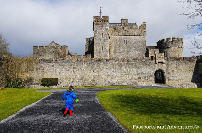 A young boy playing in the Outer Ward of Cahir Castle, Ireland