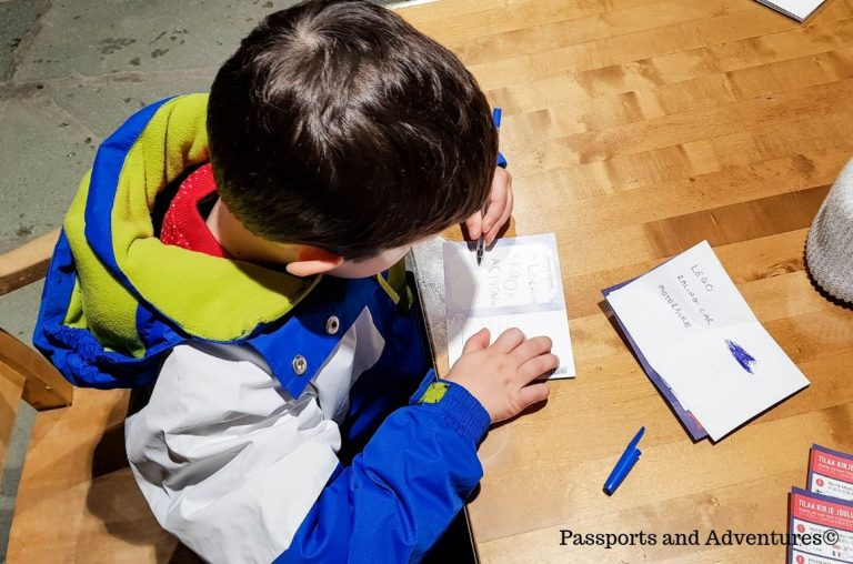 A young boy writing postcards in Santa's Main Post Office, Santa Village, Rovaniemi