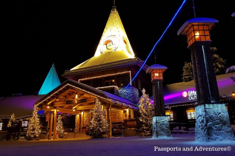 The beautiful Santa Claus Main Office and the line denoting the Arctic Circle at the Santa Claus Village, Rovaniemi at night, all lit up.