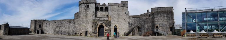 A panoramic view of the main courtyard and gatehouse of King John's Castle, Ireland