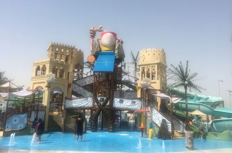 Slides and water dumps in a pool at Yas Waterworld, a waterpark in Abu Dhabi