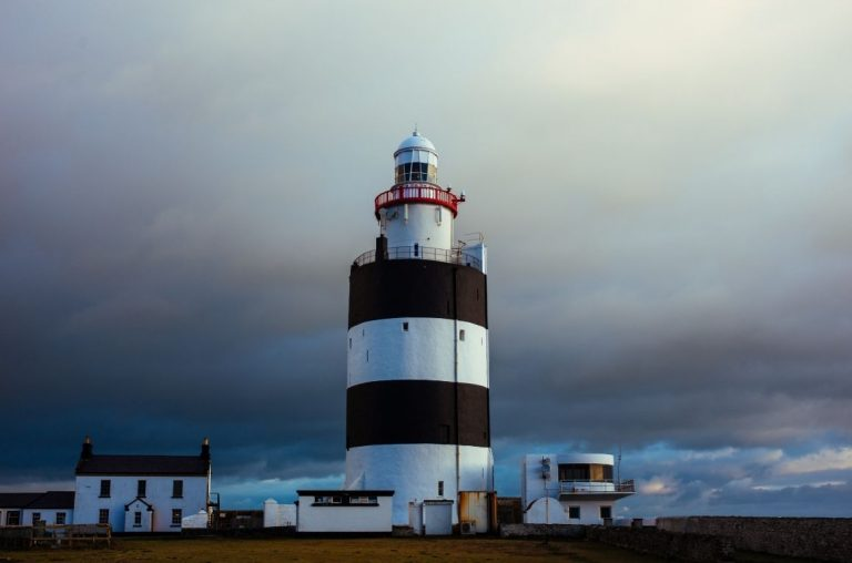 Hook Head Lighthouse with a moody, cloudy sky above it