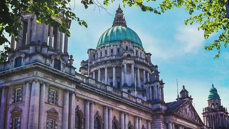 A picture of Belfast City hall with blue skies behind it