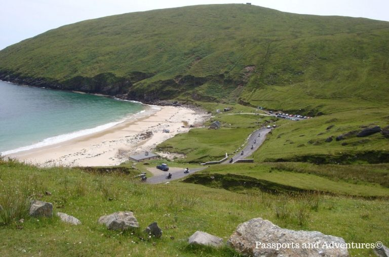 A picture of the beach at Keem Bay on Achill Island surrounded by lush green hillsides