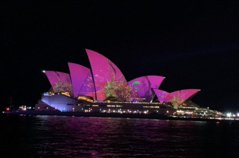 The Sydney Opera House lit up in purple at night