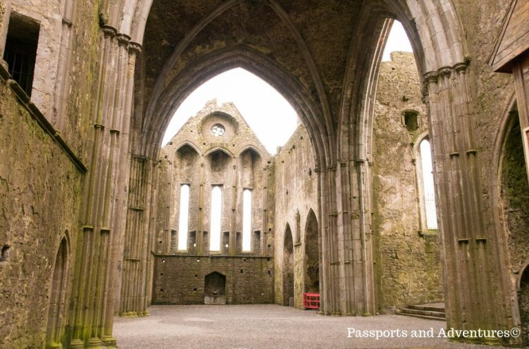 A picture inside the Rock of Cashel, with the open roof and arches of the abbey showing