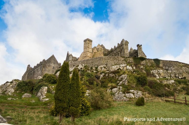 A picture of the Rock of Cashel in Ireland with blue skies behind it