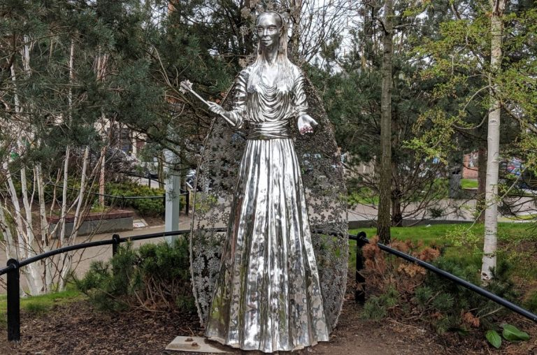 A statue of the white witch at the CS Lewis Square in Belfast