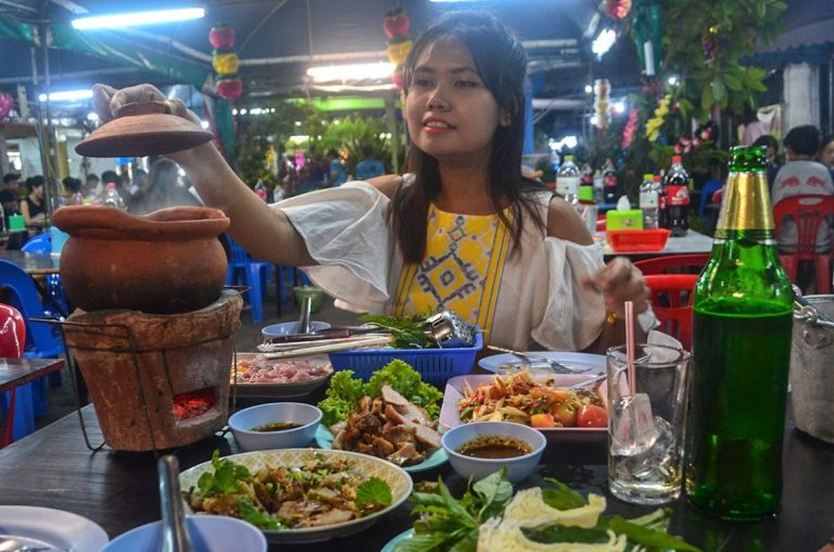 A lady enjoying a feast of Thai food in Bangkok