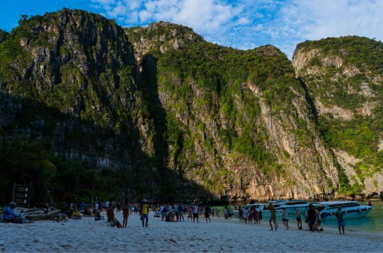 A picture showing the overcrowded tourism of Maya Bay in Thailand