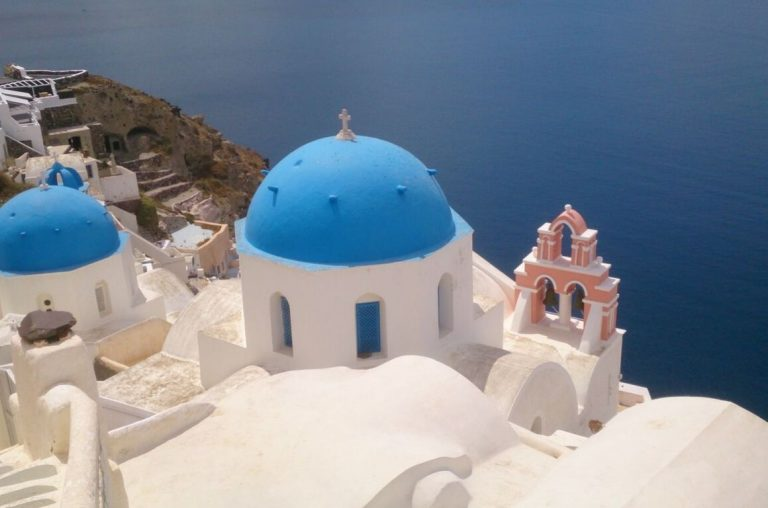 A picture of some of the blue roof tops of the Greek town of Santorini