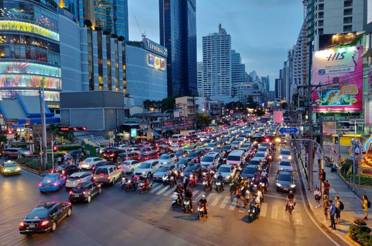 A night scene of an intersection of roads in Bangkok showing the huge volume of traffic