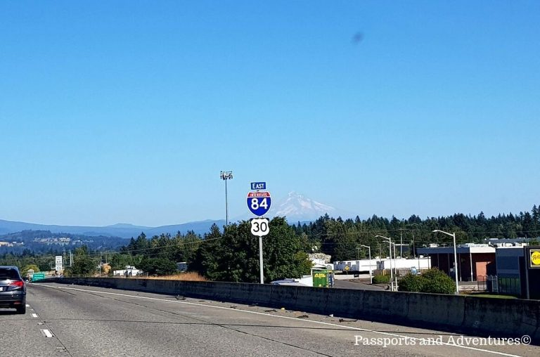 A sign of Interstate 84 with snowcapped Mount Hood in the background in Oregon, USA