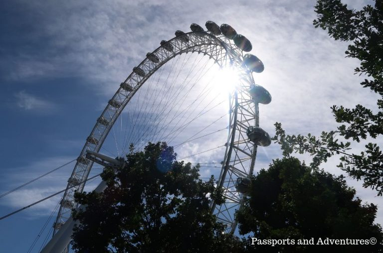 A upward view of the London Eye with the sun shining through the wheel