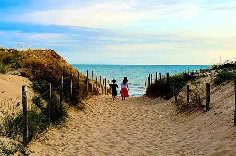 Two kids walking down to the beach near Le Clarys Plage in France