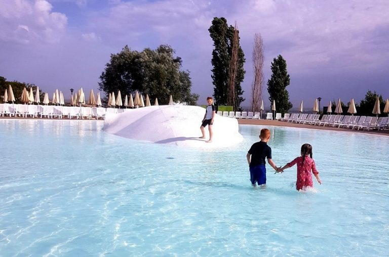 Three young kids enjoying the waterpark pool at camping fabulous just outside of Rome