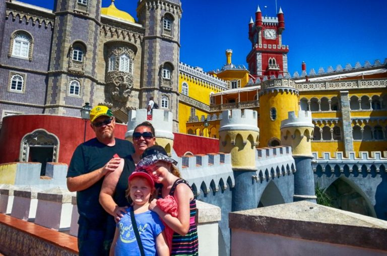 The Wyld Family standing in front of Pena Palace in Sintra near Lisbon