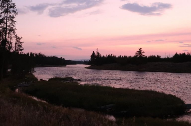 A deep pink sky for sunset over the Madison River in Yellowstone