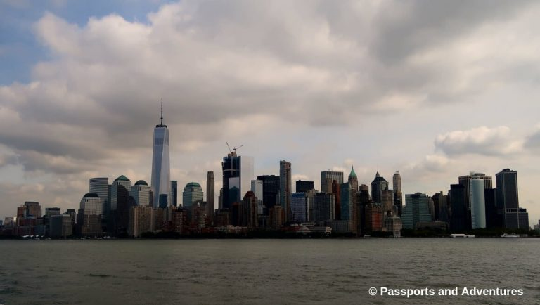 A view of Manhattan from across the water with a cloudy sky