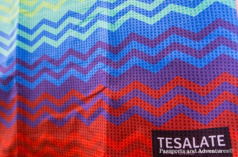 A picture of a wave pattern on a Tesalate Beach Towel in blues, purples and reds