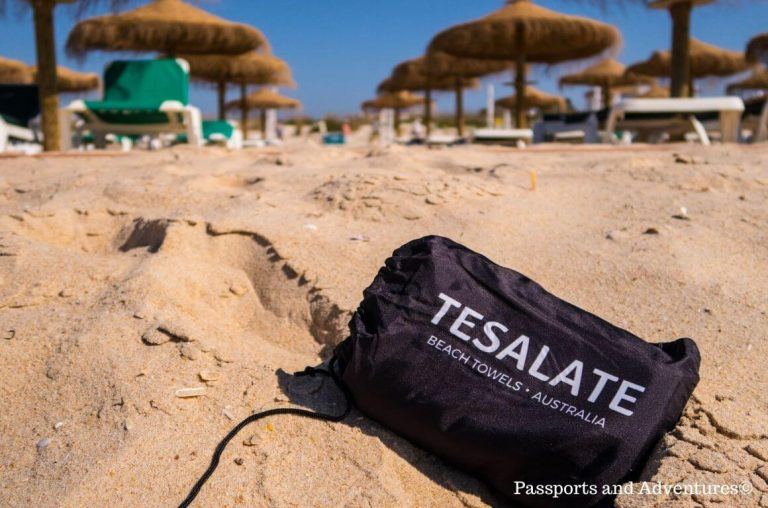 A picture of a Tesalate Beach Towel bag on a beach