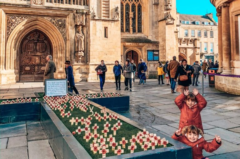 A picture of two little girls outside Bath Abbey