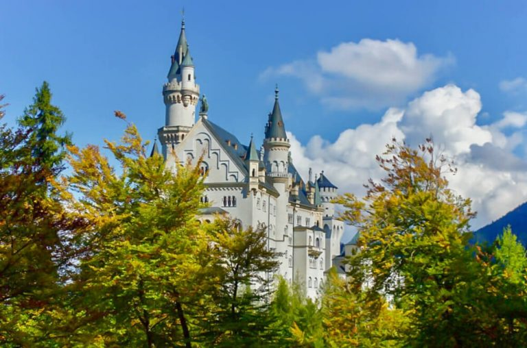 A picture of Neuschwanstein Castle through trees
